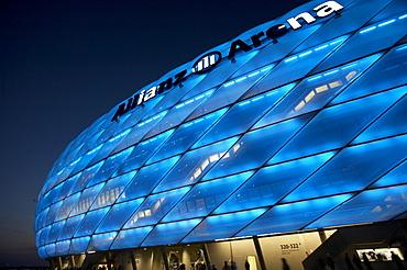 Colorful lit Allianz Arena football stadium at night, Munich, Bavaria, Germany