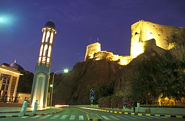 Illuminated mosque and fort at night, Muscat, Oman, Middle East, Asia
