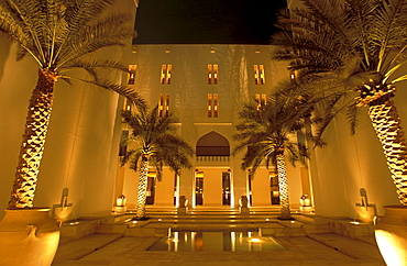 Illuminated atrium of the Chedi Hotel at night, Muscat, Oman