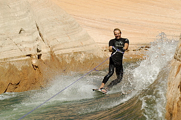 A man wakeboarding on Lake Powell, Arizona, USA