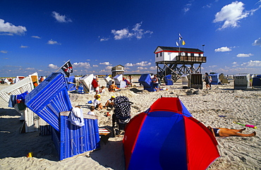 Beach chairs and stilted house under blue sky, St. Peter Ording, Eiderstedt peninsula, Schleswig Holstein, Germany, Europe