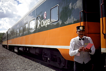 A conductor standing in front of a train, Ferrocarril Chihuahua al Pacifico, Chihuahua express, Mexico, America