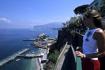 Woman looking over sorrento Coastline, Campania, Italy