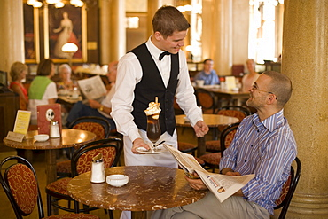 Waiter serving coffee ice, Cafe Central, Waiter serving coffee ice to a guest of Cafe Central, Vienna, Austria