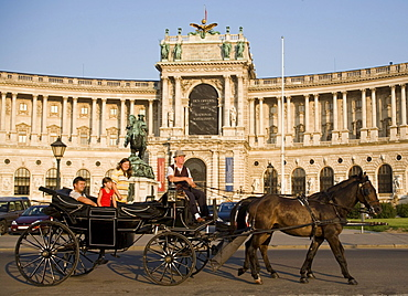 Fiaker passing the Neue Hofburg during a city tour, Vienna, Austria