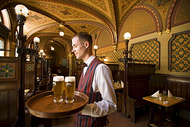 Waiter serving beer in the Karpatia Restaurant, Waiter serving beers in the Karpatia Restaurant, Pest, Budapest, Hungary