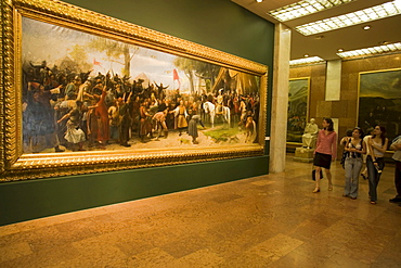 People looking at painting, Visitors looking at a painting inside the Hungarian National Gallery at Royal Palace on Castle Hill, Buda, Budapest, Hungary