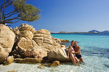 Couple at Spiaggia Capriccioli, Costa Smeralda, Sardinia, Italy