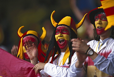Spanish football fans wearing a helmet