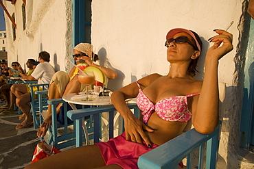 Women sitting in front of the Caprice Bar, Little Venice, Mykonos-Town, Mykonos, Greece