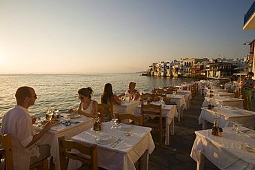 People sitting in a restaurant at beach, Little Venice, Mykonos-Town, Mykonos, Greece