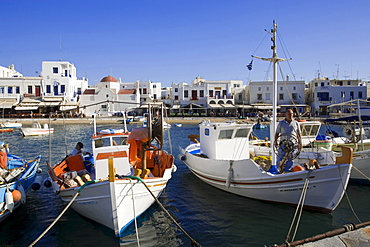 Fishermen on their boats in the harbour, Mykonos-Town, Mykonos, Greece