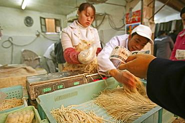 noodle shop, fresh noodles, sales, market hall, paying with Yuan note, cash