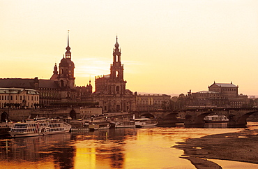 Europe, Germany, Saxony, Dresden, Skyline of Dresden with Bruehlsche terrace, Residenzschloss, Staendehaus, Haussman Tower and Catholic Court Church and Semper Opera seen from Carola bridge on Elbe River
