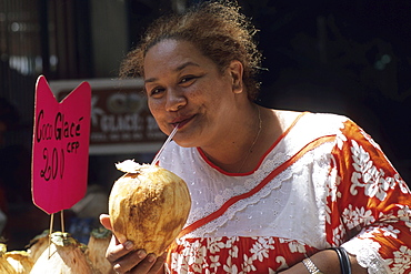 Woman Sipping Chilled Coconut Water, Papeete Municipal Market, Papeete, Tahiti, French Polynesia