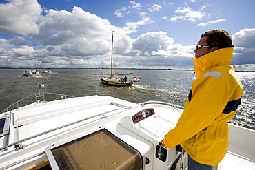 Houseboat Skipper Navigating Koevorde Lake, Crown Blue Line Royal Classic, Frisian Lake District, Netherlands