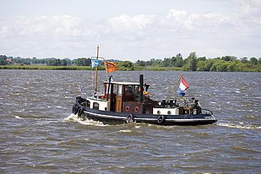 Historic Tugboat Houseboat, Noorder Oudeweg Waterway, near Joure, Frisian Lake District, Netherlands