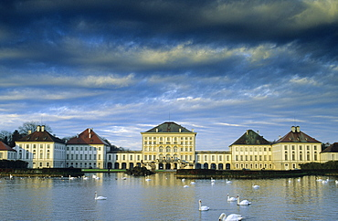 Europe, Germany, Bavaria, Munich, Nymphenburg Palace, swans on the Nymphenburg canal in front of the Palace