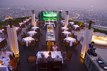 """View over openair-bar """"Sirocco Sky Bar"""" and Bangkok in the evening, State Tower, 247 m, The Dome, Bangkok, Thailand"""