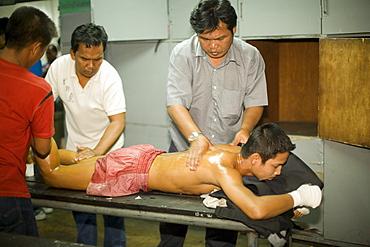 Thai Boxer getting a massage, Thai Boxing, Lumphini Stadium, Bangkok, Thailand