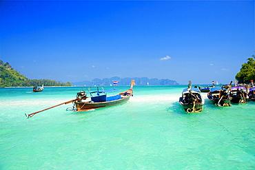 Boats anchored at Chicken Island, Laem Phra Nang, Railay, Krabi, Thailand, after the tsunami