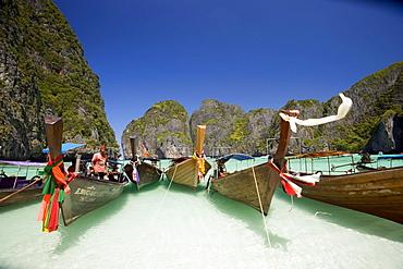 "Boats anchoring in the Maya Bay, a beautiful scenic lagoon, famous for the Hollywood film ""The Beach"", Ko Phi-Phi Leh, Ko Phi-Phi Islands, Krabi, Thailand, after the tsunami"