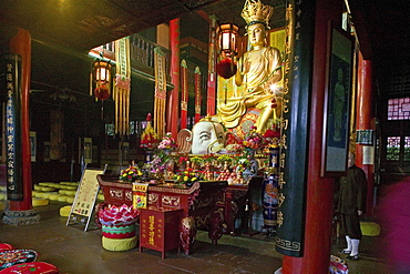 Golden statue of Buddha with white elephant at Wannian monastery, Emei Shan, Sichuan province, China, Asia
