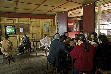 monks having lunch, TV, canteen of the monastery, Xixiang Chi monastery and temple, Elephant Bathing Pool, China, Asia, World Heritage Site, UNESCO