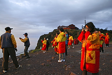 pilgrims and tourists, early morning sunrise and sea of clouds, 3077 metre altitude, Golden Summit, summit of Emei Shan mountains, World Heritage Site, UNESCO, China, Asia