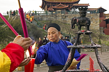 pilgrims and tourists burning incense sticks and candles, 3077 metre altitude, Golden Summit, summit of Emei Shan mountains, World Heritage Site, UNESCO, China, Asia