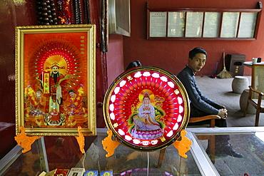 Illuminated Buddha images at a souvenir shop, Heng Shan South, Hunan province, China, Asia