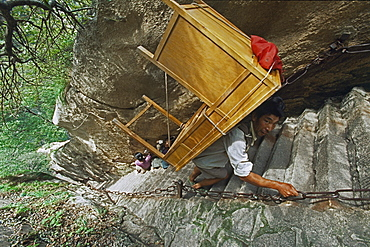 porter, porters carry furniture, building material on his back up steep mountain steps, Taoist mountain, Hua Shan, Shaanxi province, Taoist mountain, China, Asia
