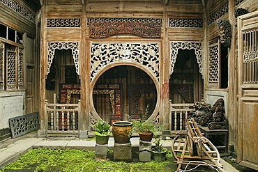 Idyllic courtyard with carved wooden walls, Hongcun, Huangschan, China, Asia
