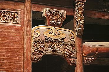 Artful carvings at the roof beam of a house at the village Hongcun, Huang Shan, China, Asia