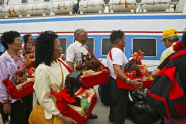 pilgrims at ferry, Buddha statues from house altars brought to Guanyin, Goddess of Mercy, Buddhist Island of Putuo Shan near Shanghai, Zhejiang Province, East China Sea, China, Asia