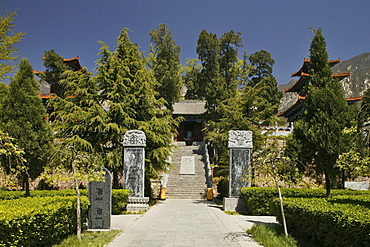 Fa Wang Buddhist monastery main entrance through the garden, Taoist Buddhist mountain, Song Shan, Henan province, China, Asia