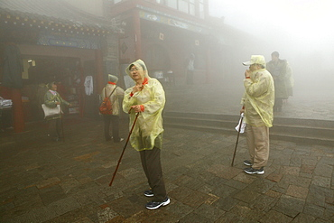 Pilgrims, tourists in rain capes at the entrance to Bixia Si temple, Mount Tai, Tai Shan, Shandong province, World Heritage, UNESCO, China