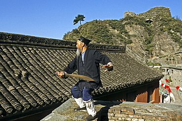 Taichi master and monk demonstrating a ritual sword fight, Tianzhu feng temple, Mount Wudang, Wudang Shan, Taoist mountain, Hubei province, UNESCO world cultural heritage site, birthplace of Tai chi, China