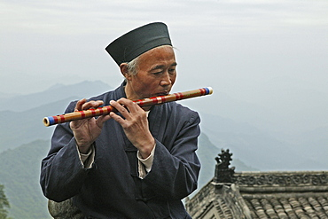 Monk playing the flute, Mount Wudang, Wudang Shan, Taoist mountain, Hubei province, UNESCO world cultural heritage site, birthplace of Tai chi, China