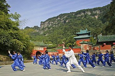 Taichi training from Wudang School of Martial Arts, in front of Purple Heaven Hall, Zi Xiao Gong, peak 1613 metres high, Wudang Shan, Taoist mountain, Hubei province, Wudangshan, Mount Wudang, UNESCO world cultural heritage site, birthplace of Tai chi, China, Asia