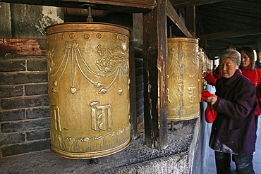 pilgrims circle and turn the prayer wheels at the base of the Great White Pagoda, during birthday of Wenshu, Monastery, Wutai Shan, Five Terrace Mountain, Buddhist Centre, town of Taihuai, Shanxi province, China, Asia