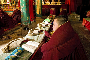 Prayer ceremony in Pusa Ding monastery, yellow cap monks, Wutai Shan, Five Terrace Mountain, Buddhist Centre, town of Taihuai, Shanxi province, China