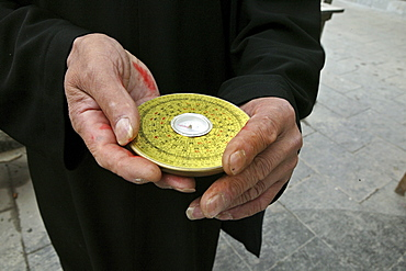Chinese Feng Shui compass, a Lopan, in hands of Fengshui master, China, Asia