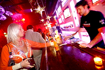 Woman ordering a drink, Club Radost, New Town, Nove Mesto, Prague, Czech Republic