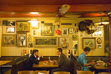 Guests sitting in the restaurant Zum Weissen Kreuz, Zurich, Canton Zurich, Switzerland