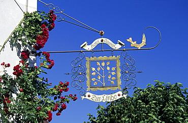 Wrought-iron sign for restaurant Zur Linde, Fraueninsel Island, Lake Chiemsee, Chiemgau, Upper Bavaria, Bavaria, Germany