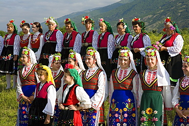 Women and girls in traditional costumes at Rose Festival, Karlovo, Bulgaria, Europe