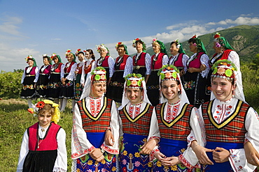 Girls and women in traditional costumes at Rose Festival, Karlovo, Bulgaria, Europe