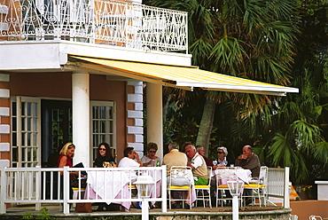 People having dinner on the terrace, Waterloo House, Hamilton, Bermuda