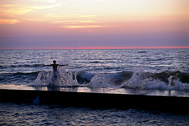 Swimmer standing on jetty of Havsbad, Visby, Gotland, Sweden